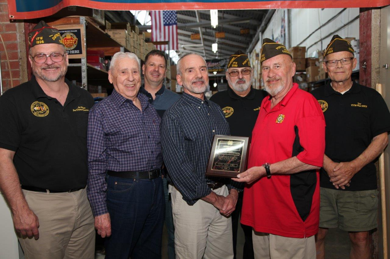 A plaque was presented to HobbyTyme Distributors by members of VFW Post 2083, East Hartford CT.